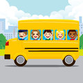 Kids riding school bus happy and driver yellow through city road Royalty Free Stock Images