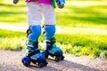 Kids roller skating in summer park Royalty Free Stock Photo