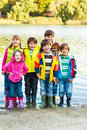 Kids in rubber boots Stock Image