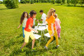 Kids run around playing musical chairs game a outside in summer period Royalty Free Stock Photos