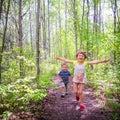 Kids running happy in woods Stock Images