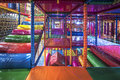 Kids running inside a Colorful indoor playground