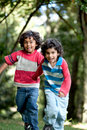 Kids running outdoors Stock Image