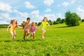 Kids running in the park together and years old diversity looking boys and girls Royalty Free Stock Photos