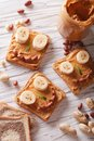 Kids sandwiches with peanut cream and banana. top view Royalty Free Stock Photo