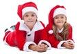 Kids In Santa Costumes At Chri...