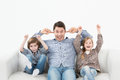 Kids screaming on the couch Stock Photos