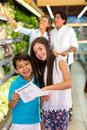 Kids with shopping list Royalty Free Stock Photo