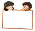 Kids showing board Stock Photography