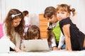 Kids sit around laptop Royalty Free Stock Photo