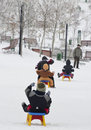 Kids on the sledge Stock Photo