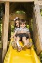 Kids on slide. Royalty Free Stock Photo