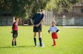 Kids soccer beginning on football match for Royalty Free Stock Photography