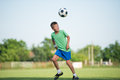 Kids soccer little boy running dribbling on the sports field Stock Image