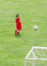 Kids soccer little boy shooting at goal Stock Image