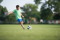 Kids soccer little boy shooting at goal Royalty Free Stock Photography