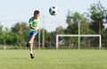 Kids soccer little boy shooting at goal Royalty Free Stock Photo