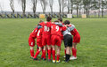Kids soccer team huddle Stock Images