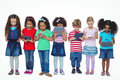 Kids standing together holding tablets and phones Royalty Free Stock Photo