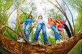 Kids standing together on trunk of fallen tree Royalty Free Stock Photo