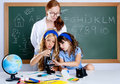 Kids students with nerd teacher woman at school Stock Photography