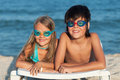 Kids with swimming goggles on the beach Royalty Free Stock Photo