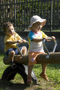 Kids on swing in the park Royalty Free Stock Photo