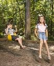 Kids on swing set. Royalty Free Stock Photo