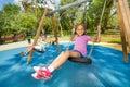 Kids swinging on playground Royalty Free Stock Photo