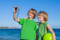 Kids taking selfie on holiday in Mallorca Spain Royalty Free Stock Photo