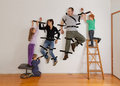 Kids teamwork taping parents to wall working together tape as revenge digitally manipulated Royalty Free Stock Photos