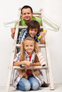 Kids and their father getting ready to paint the room Royalty Free Stock Photo