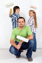 Kids and their father painting a room Royalty Free Stock Image