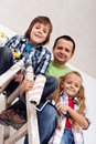 Kids and their father ready to paint the room Royalty Free Stock Photos