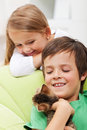 Kids with their new pet a playful kitten Stock Image