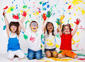 Kids with their palms and clothing painted Royalty Free Stock Photos