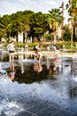 Kids and their parents play in the water fountain Royalty Free Stock Photo