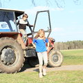 Kids and tractor little boy girl leaving an old red vehicle Royalty Free Stock Photos