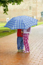 Kids under the umbrella Royalty Free Stock Image