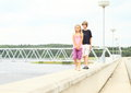 Kids walking on railing of dam two little girl and boy concrete a Stock Photos