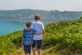 Kids walking towards the sea at a beautiful bay in normandy Royalty Free Stock Photography