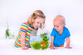 Kids watching fish bowl Royalty Free Stock Photo