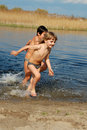 Kids In Water Stock Photos