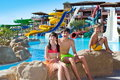 Kids by the water slides Royalty Free Stock Photo