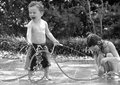 Kids and Waterplay Royalty Free Stock Image