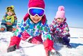 Kids in wintertime group of children playing on snow winter time Royalty Free Stock Photos