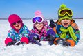 Kids in wintertime group of children playing on snow winter time Stock Photography