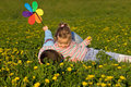 Kids wrestling on the flower field Stock Photo