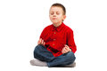 Kids yoga boy relaxing on a white background Stock Photos