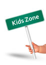 Kids zone message board in kid hand Stock Photo
